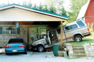 Dog Crashes Truck Into Carport, Totals Car