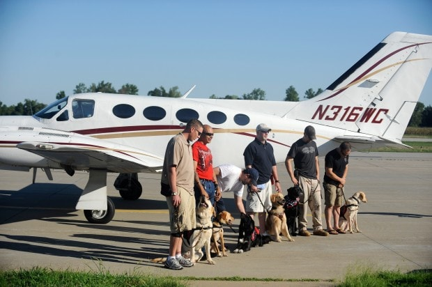 Service Dogs Help Military Vets Reach New Heights