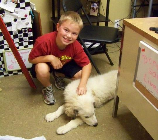 Hayden, seen here with Slicer, the pup he has donated his piggy bank to.