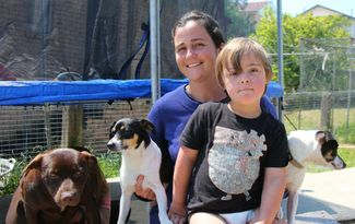 Lost boy with down syndrome found cuddled with his dogs