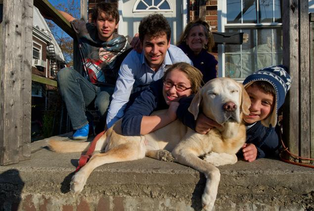 Sandy the dog survives Hurricane Sandy and is reunited with his family