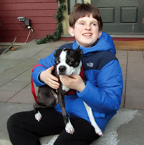 Twelve-year-old boy raising money to save the sight of his neighbor's dog