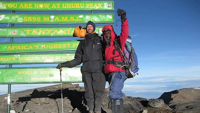 Blind man climbs Mount Kilimanjaro to honor his guide dog