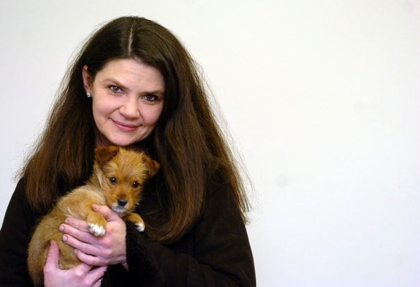 Woman saves puppy from icy canal