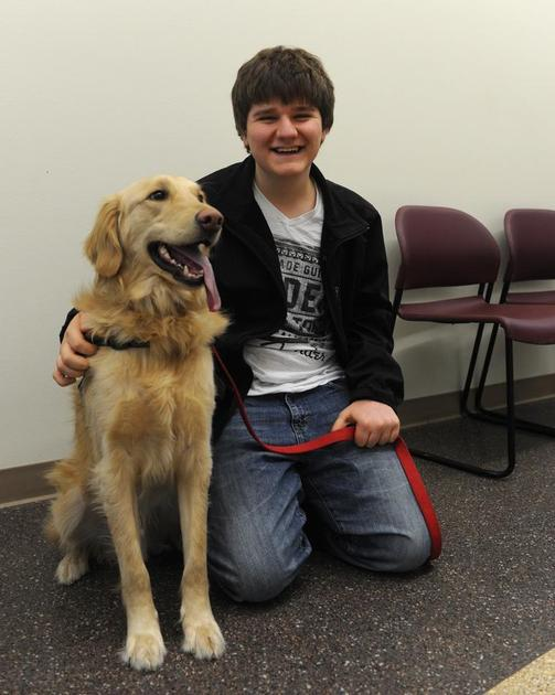 Service dog helping teen face the world