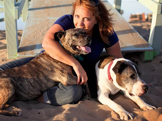 "Lori Fusaro with her loves, Gabby and Sunny.  ""When you bring dogs out of a shelter, they start realizing that they're safe and they're being loved by a new family,"" Fusaro said. ""They come out of their shell and want to experience life."""