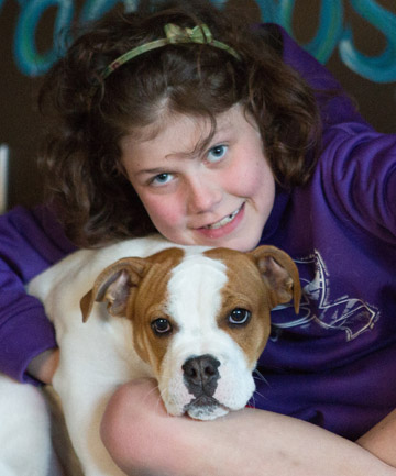 Little Girl Who Spent her Childhood Sick Finally Gets the Puppy she Always Wanted
