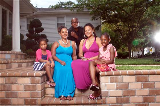 Genelle Guzman-McMillan (blue dress)  pictured with her husband, Roger, and daughters Kimberly, Kaydi and Kellie at their home in Long Island, N.Y., on Aug. 7, 2011.  Photo by Dan Callister.