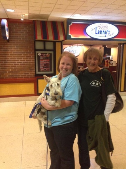 Suzie Brooks (L) and Cheri Davis (R) prepare to take Doogie home.