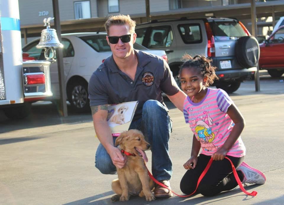Firefighters Donates Seizure Alert Dog to Little Girl
