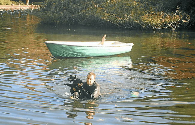 Police Rescue Dog from Lake