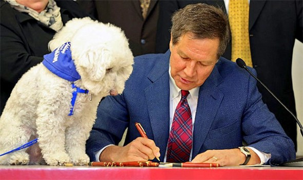Barbara McKelvey came down for the event.  Her dog, Sammy, looks on as Ohio Governor John Kasich signs the bill into law.