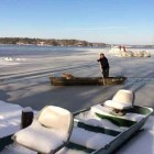 Man Rescues Dog from Icy Reservoir