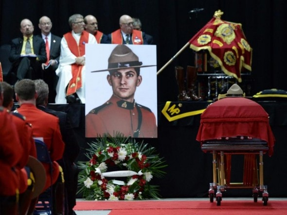 6.12.14 - Canine Partner of Slain Mountie Cries at Funeral3