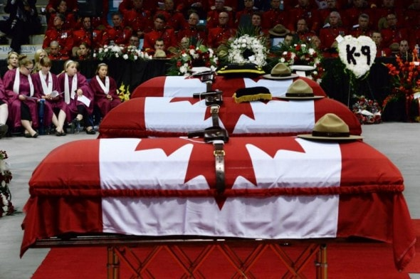 6.12.14 - Canine Partner of Slain Mountie Cries at Funeral4