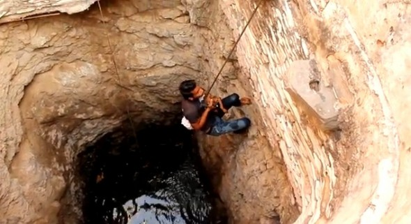 6.18.14 - Indian Community Rescues Drowning Puppy Moments from Death2
