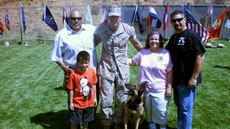 14 family of deceased marine adopts dog he served with overseas