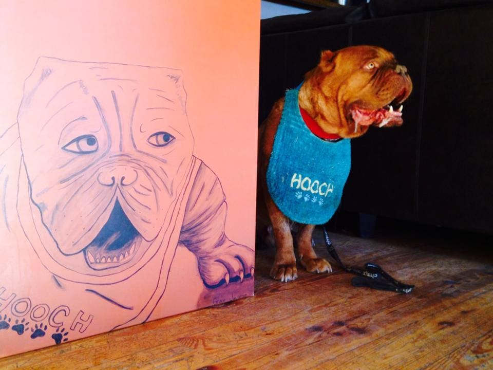 Hooch poses with his likeness, as done by his teenaged friend Grace Juanese.