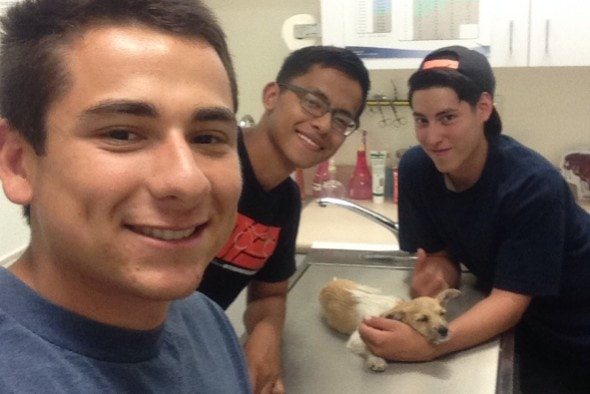 Ninja with his rescuers at the vet. Photo Credit: Isaac Gonzales