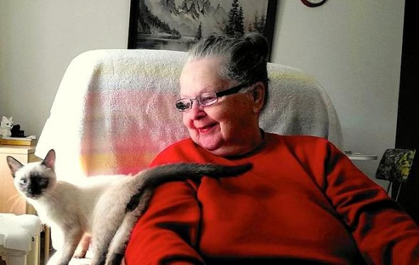 Mary St. Clair and her cat Thai are helped by the Animeals program.