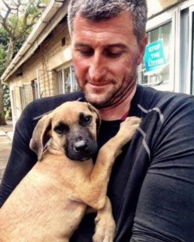 Enzo with his new dad. Photo credit: DARG/Facebook