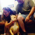 Tara with her adoptive parents. Humane Society of Forsyth County (HSFC)
