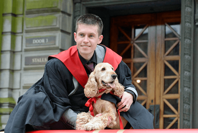 Dog Graduates with Honors from University