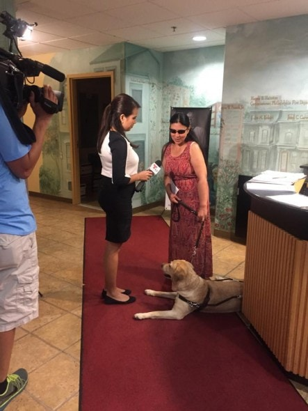 Yolanda and her owner doing TV interviews. Photo Credit: Red Paw Emergency Relief Team