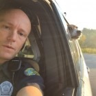 Cop Takes Selfie with Outlaw Dog