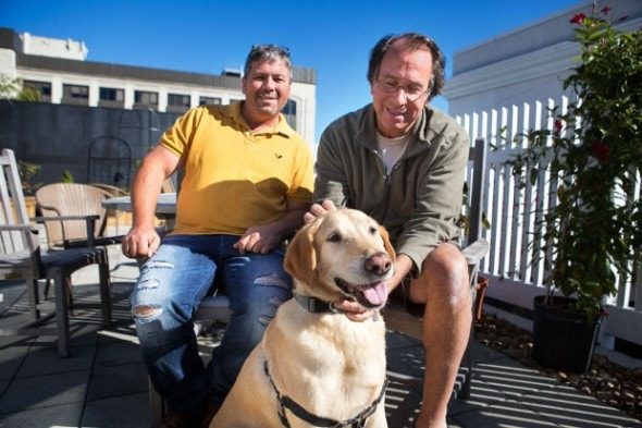 Dog rescuer Greg Mahle and journalist/author Peter Zheulin with his dog Albie at the WBUR studios. (Jesse Costa/WBUR)