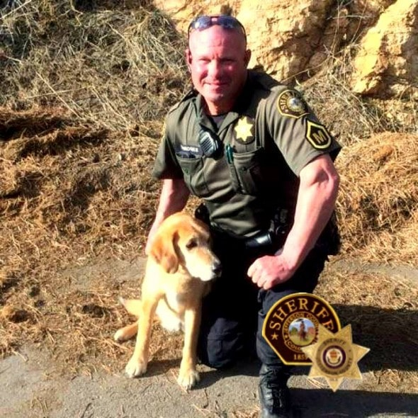 2.18.16 - Sheriff's Deputy Jumps into Frozen Pond to Save Unconscious Dog1
