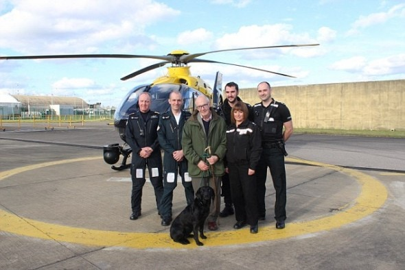 Mr. Kay and Holly Blue with their rescuers.