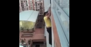 Man Hangs from 13th-Story Balcony to Rescue Dangling Dog