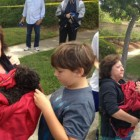 Sparky post-rescue, safe in the arms of his family. (Photo: OCFD)