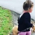 Little Girl Starts Career as Dog-Walker VERY Early in Life