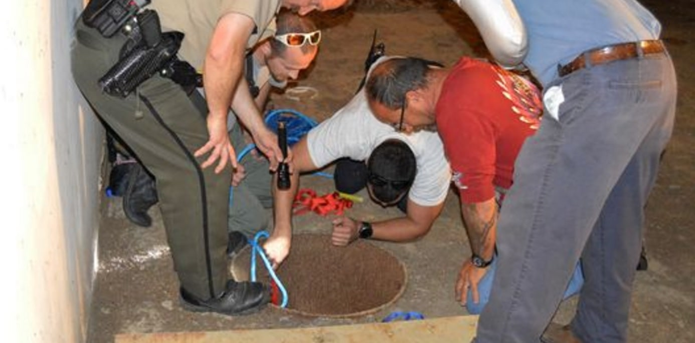 Worker Hears Cries of Help from Dog Stuck in 30-Foot Deep Hole