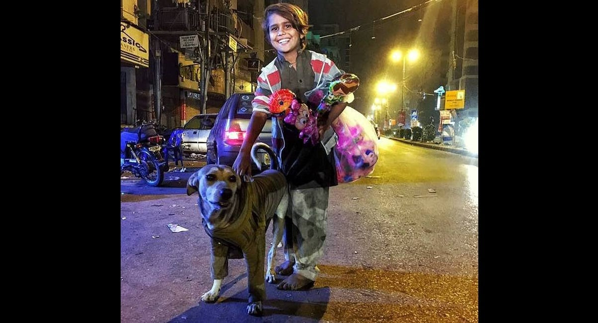 Boy Who Doesn't Even Have Shoes Gives His Sweater to a Cold Street Dog