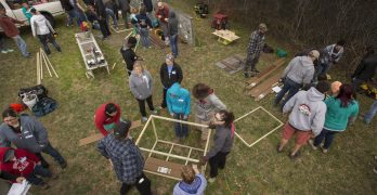 Over 140 Volunteers Come Together to Build Dog Houses for Police Dogs