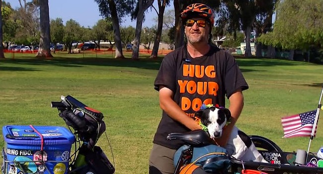 Rescue Dog (& Her Human!) Break Guinness Record For Longest Electric Bike Trip