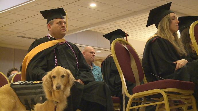 FSU Grants Graduate's Service Dog Special Leash and Patch to Acknowledge All She Does
