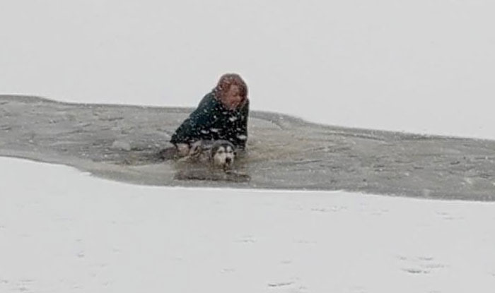 Fearless Woman Doesn't Hesitate, Marches Straight Into Frozen Lake To Save Stranger's Dog