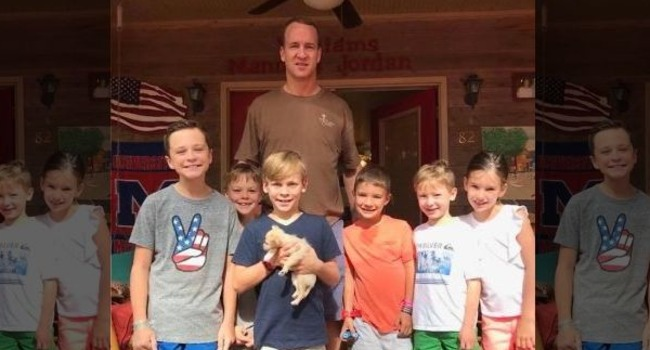 Peyton Manning adopts tiny, two-pound rescue pup