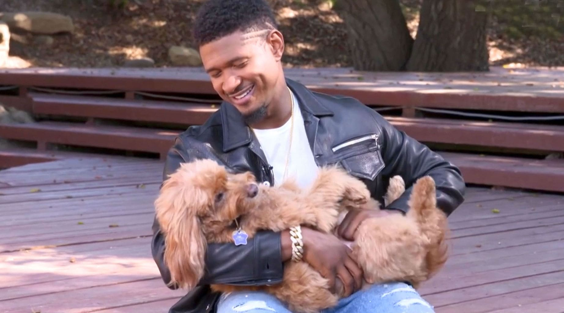 Singer Usher is completely in love with his goldendoodle, Scarlett